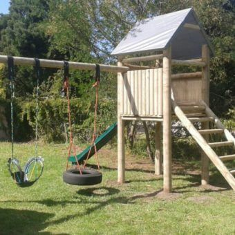 Forest House with slide and backyard swing sets