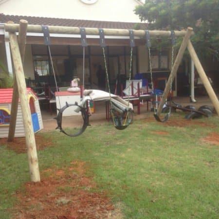 Triple log childrens swings