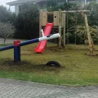 Painted Log Seesaw